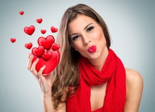 Attractive smiling woman with red heart